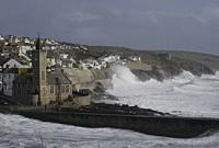 PORTHLEVEN, UK - 03 Mar 2019 - Spectators watch huge waves that came in with Storm Freya amid wind gusts of around 60mph at Porthleven Cornwall Englan...
