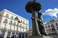 Statue of Bear and strawberry tree symbol of Madrid in Puerta del Sol square in the city centre, Madrid, Spain.