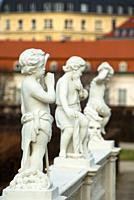 Little marble cherubs at Belvedere Palace formal gardens, Vienna, Austria.