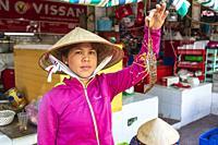 Vietnamese woman selling ffresh lobster at Ben Thanh street market, Ho Chi Minh city, Vietnamese, Asia.