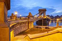 Dawn at Chain Bridge across the Danube in Budapest, Hungary.