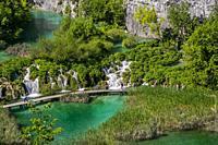 Plitvice Lakes National Park. Lika Plješivica mountain range . The park falls within two counties Lika-Senj and Karlovac . UNESCO World Heritage Site,...