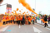 Aliexpress, celebrating its 9th anniversary with a colorful holi run in Valdebebas, Madrid, Spain. There were more than 6000 participants. Race start ...