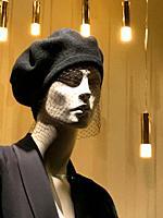 Mannequin wearing hat with veil in a shop window. Serrano street, Madrid, Spain.