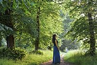 young woman walking around in the Park of the Chateau of Rambouillet, Forest of Rambouillet, Haute Vallee de Chevreuse Regional Natural Park, Yvelines...