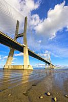 Vasco de Gama Bridge reflecting in the Tagus river, Lisbon, Portugal.