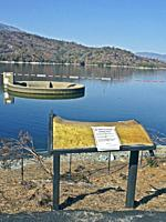 Melted sign remains on shore of Whiskeytown Lake in northern California following the 2018 Carr fire. The fire started in July 2018 by a disabled vehi...