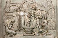 ancient bas-relief depicting the baptism of Christ.