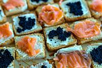 Detail photo of salmon canapes and caviar.