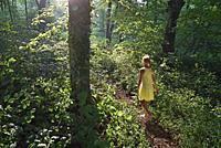 little girl walking around in the Park of the Chateau of Rambouillet, Forest of Rambouillet, Haute Vallee de Chevreuse Regional Natural Park, Yvelines...