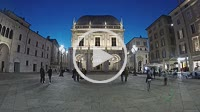 Brescia, Italy, March 16, 2019: Timelapse in the night at Piazza della Loggia in Brescia, view of the Palazzo della Loggia and the people walking, the...