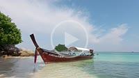 Traditional longtail boat in Thailand near the beach of beautiful Ko Lipe island