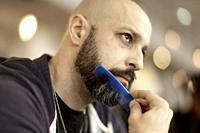 Man combing his beard