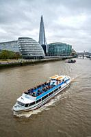 Tour boat on the river Thames , London, England.