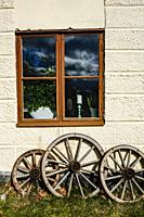 Stockholm, Sweden A window and old carriage wheels at Rosersbergs Slott or Rosersbergs Castle, a royal palace from 1634 in the Sigtuna municipality ou...
