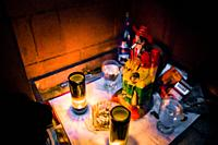 An altar of San Simón (a patron saint of sex workers), surrounded by offerings, is seen placed underneath the bar in a sex club in San Salvador, El Sa...