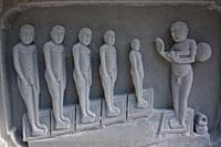 Stone carving depicting jain monks in a jain temple under construction. At Kundalpur ( Madhya pradesh, India).