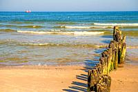 old groins in the Baltic Sea with blue sky.
