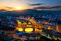 Cityscape and bridges of Florence in early morning.