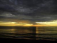 Sea turned to gold at sunrise, Virginia Beach Virginia.