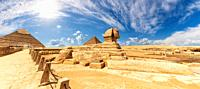 The Sphinx in front of the Pyramids, beautiful panoramic view.