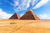 The Giza Pyramids in the desert, sunny day scenery.
