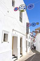 Andalusian village decorated with crochet crafts. White village Arcos de la Frontera, Cadiz, Andalusia, Spain.