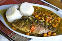 Traditional Local Fish Stew Dish, Fresh Tilapia (Ngege) with Rice, served at the Baboon Safari Resort, Queen Elizabeth National Park, Uganda, East Afr...