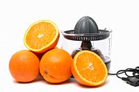 Automatic orange juicer machine isolated on a white background.