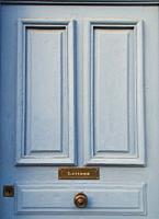 pale blue door with letter slot, Greoux les Bains, Provence, France.