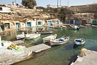 View to the fisherman houses with fishing boats and boat shelters in Mandrakia village, Milos, Cyclades Islands, Greek Islands, Greece, Europe
