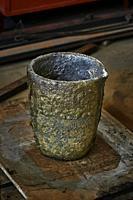 Melting Pot Used To Casting A Bronze Scuplture. Sculpture artist's workshop.