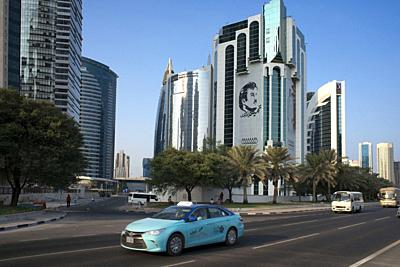 Taxi in Al Corniche street in the financial area of Doha, the capital of Qatar in the Arabian Gulf country.