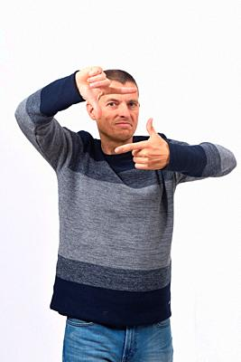 man making the gesture of frame.