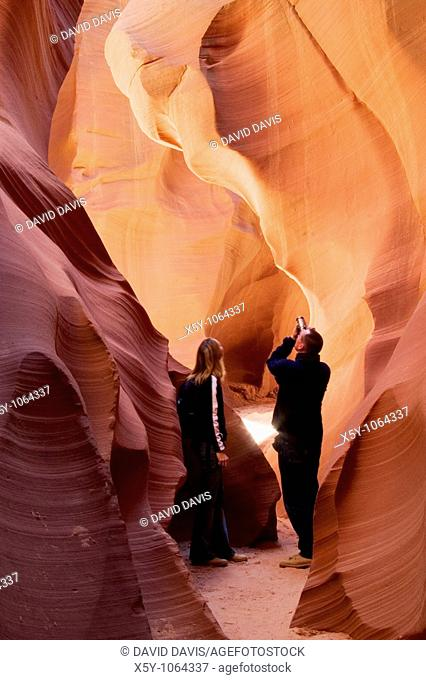 Couple photographing the inside of Lower Antelope Slot Canyon, Page, Arizona  No Release