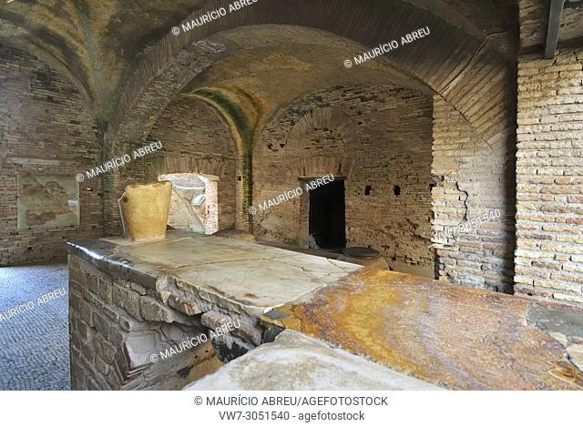The Thermopolium in front of the House of Diana. The Thermopolium was an ancient roman café where were served hot wine with honey and some food, Ostia Antica