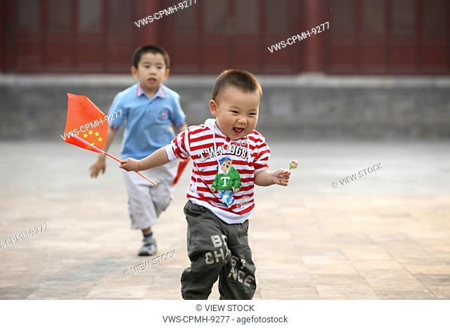 Chinese Children Being In Forbidden City,Beijing,China