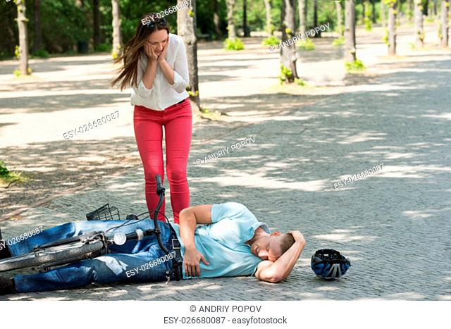 Woman Getting Worried Over Man Injured In Bicycle Accident