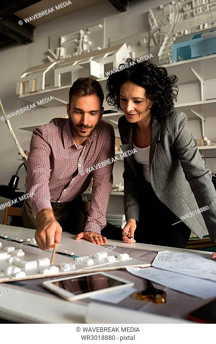 Male and female architects working