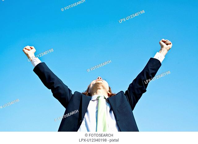 Businessman with Hands Raised
