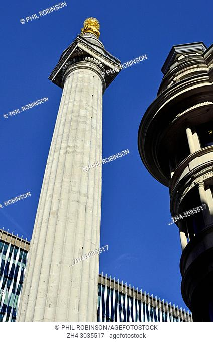 London, England, UK. Monument (to the Great Fire of London) at the junction of Monument Street and Fish Street Hill (Doric column - 1677: Sir Christopher Wren /...