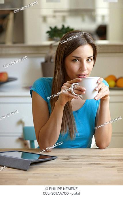 Woman taking coffee break