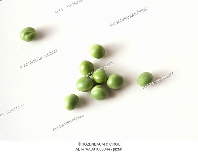 Greens peas against white background, close-up