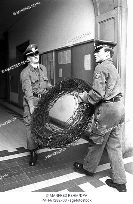 After the police had cleared Goethe-University of students who had occupied the university on 30 May 1968, they put up barbed wire at the entrance to protect...