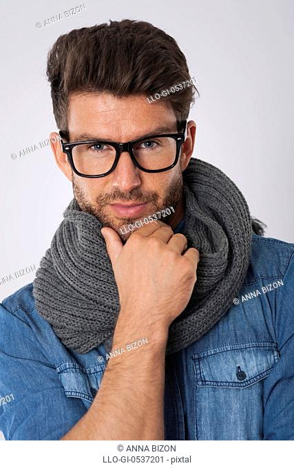 Handsome man with fashion glasses and scarf. Debica, Poland
