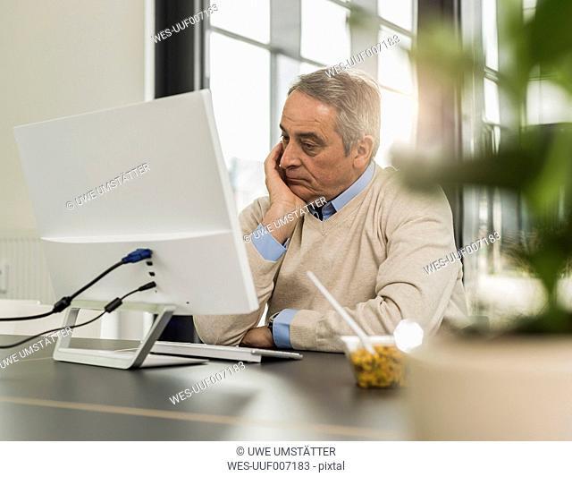 Senior man in office
