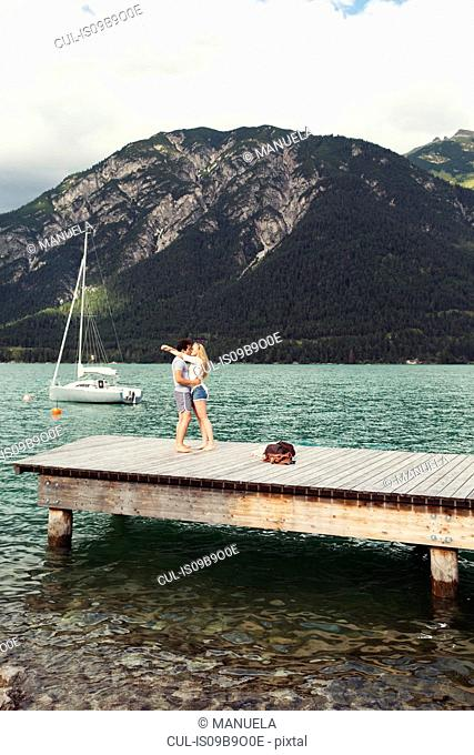 Couple on pier kissing, Achensee, Innsbruck, Tirol, Austria, Europe