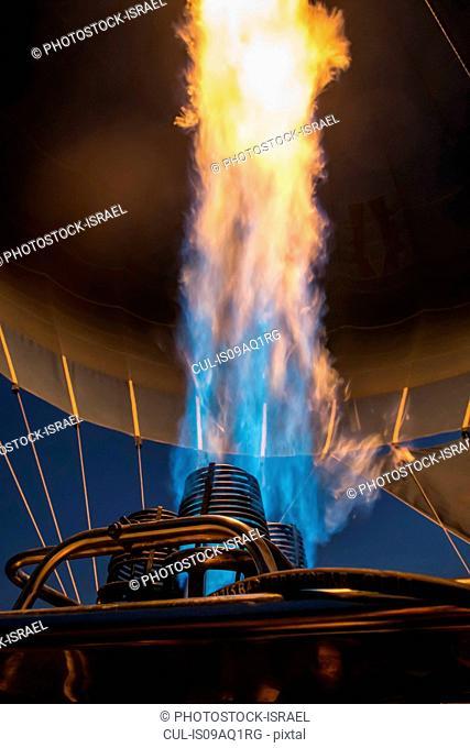 Close up of hot air balloon gas flame at night