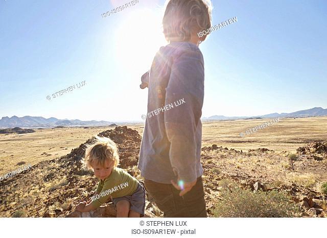 Boys playing in desert, Walvis Bay, Namib-Naukluft National Park, Namibia