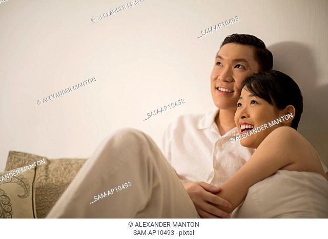 Singapore, Man and woman embracing and smiling